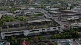 Aerial drone view. Flying over old factory or Warehouse ruin industrial building for demolition.