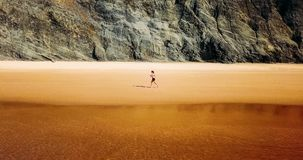 Aerial Drone View Of Healthy Sportive Woman Running On Beach Stock Photo
