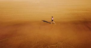 Aerial Drone View Of Healthy Sportive Woman Running On Beach Stock Photos