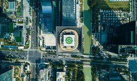 Aerial drone view of helipad on the roof of a skyscraper iin downtown with cityscape view on sunny day stock photo