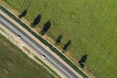 Aerial view of a highway passing through green fields Stock Images