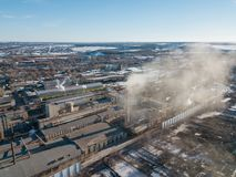 Aerial drone view of industrial area of refractory plant. Fuming pipes of factory. Industrial air pollution concept.  royalty free stock image