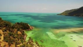 Aerial drone view island Koh Phangan Thailand. Exotic coast panoramic landscape, Chaloklum Malibu fisherman beach. Summer day. Sandy path, corals. Vivid stock video footage