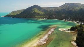 Aerial drone view island Koh Phangan Thailand. Exotic coast panoramic landscape, Chaloklum Malibu fisherman beach. Summer day. Sandy path, corals. Vivid stock footage