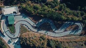 Aerial drone view of kart race, Turkey. Aerial drone footage of a kart racing in the forest, training of local racers, top down view, tripod mode, sunny evening stock footage