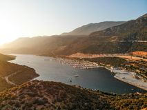 Aerial Drone View of Kas Marina Dock Pier with Small Boats and Yachts in Antalya Turkey. Vacation in Turkey royalty free stock photography