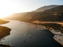 Aerial Drone View of Kas Marina Dock Pier with Small Boats and Yachts in Antalya Turkey. Vacation in Turkey royalty free stock images