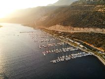 Aerial Drone View of Kas Marina Dock Pier with Small Boats and Yachts in Antalya Turkey. Vacation in Turkey stock image