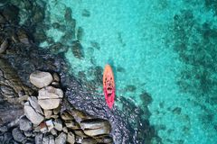 Aerial drone view of in kayak in crystal clear lagoon sea water during summer day near Koh Lipe island in Thailand. royalty free stock photography