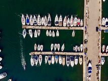 Aerial Drone View of Marina with Sailboats and Motor Boats Docked in Pier. royalty free stock image