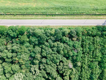 Aerial Drone View Of Moving Cars On Country Road With Forest And Agriculture Crop Field Stock Photos
