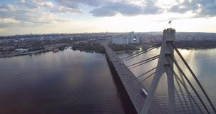 Aerial drone view of North Moscow Bridge Kiev Ukraine towards sunset river Dnepr stock video footage