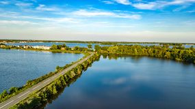 Free Aerial Drone View Of Motorway Road And Cycling Path On Polder Dam, Cars Traffic, North Holland, Netherlands Stock Images - 160705994