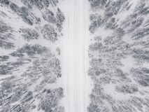 Aerial Drone View Of Winter Forest And Road Covered With Snow. Royalty Free Stock Image