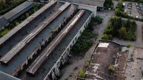 Aerial drone view. Flying over old factory ruin industrial building for demolition.