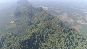 Aerial view of partially destroyed rain forest. Aerial drone view of partially destroyed rain forest in Thailand stock footage