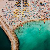 Aerial Drone View Of People Having Fun And Relaxing On Costinesti Beach In Romania stock photos