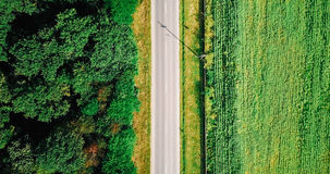 Aerial Drone View Of Road With Forest And Agriculture Crop Field Stock Images