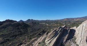 Aerial drone view of rock formations at Vasquez Rocks State Park in 4k 24 fps. Aerial drone view of rock formations at Vasquez Rocks State Park stock footage