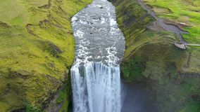 Aerial drone view of Skogafoss waterfall in Iceland, one of the country`s most famous tourist attraction stock footage