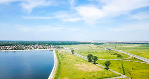 Aerial Drone View Of Small Country Town With Lake On Blue Sky Stock Photography