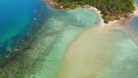 Aerial drone view small Koh Ma island, Ko Phangan Thailand. Exotic coast panoramic landscape, Mae Haad beach, summer day. Sandy path between corals. Vivid stock footage