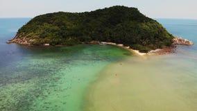 Aerial drone view small Koh Ma island, Ko Phangan Thailand. Exotic coast panoramic landscape, Mae Haad beach, summer day. Sandy path between corals. Vivid stock video footage