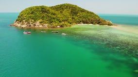Aerial drone view small Koh Ma island, Ko Phangan Thailand. Exotic coast panoramic landscape, Mae Haad beach, summer day. Sandy path between corals. Vivid stock video