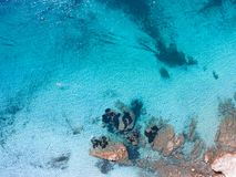Aerial drone view of swimmers swimming in shallow turquoise wate stock images