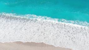 Aerial  drone view of swimming woman in the transparent turquoise sea, beautiful waves. Aerial  drone view of swimming woman in the transparent turquoise sea stock video