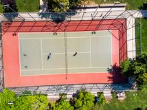 Aerial Drone View of Tennis Court in the Garden with Players Playing Tennis. royalty free stock photos