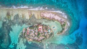 Aerial drone view of Tobacco Caye small Caribbean island in Belize Barrier Reef royalty free stock images