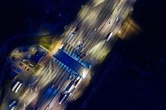 Aerial drone view on toll collection point on motorway at night. Royalty Free Stock Photo