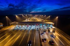 Aerial drone view on toll collection point on motorway at night. Stock Photos