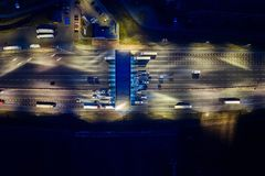Aerial drone view on toll collection point on motorway at night. Stock Images