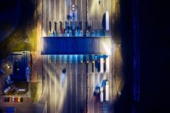 Aerial drone view on toll collection point on motorway at night. Stock Photography