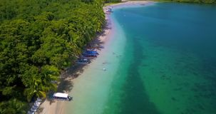 Aerial drone view of a Tropical caribbean beach in Bocas del Toro, Panama. Flying over a tropical caribbean beach in Bocas del Toro, Panama stock footage