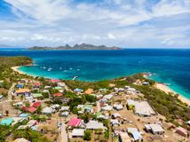 Top view of Caribbean island. Aerial drone view of tropical island of Mayreau and turquoise Caribbean sea in St Vincent and Grenadines stock photos