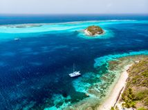 Top view of Tobago cays. Aerial drone view of tropical islands and turquoise Caribbean sea of Tobago cays in St Vincent and Grenadines royalty free stock photo