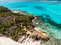 Top view of Tobago cays. Aerial drone view of tropical islands and turquoise Caribbean sea of Tobago cays in St Vincent and Grenadines stock photos