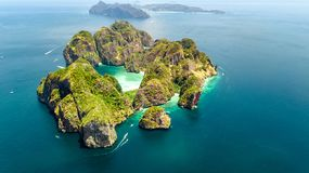 Aerial drone view of tropical Ko Phi Phi island, beaches and boats in blue clear Andaman sea water from above, Thailand royalty free stock image