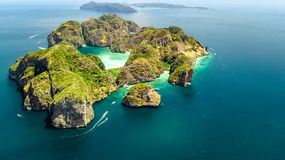 Aerial drone view of tropical Ko Phi Phi island, beaches and boats in blue clear Andaman sea water from above, Thailand royalty free stock photography
