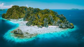 Aerial drone view of tropical Shimizu Island and pristine beach in blue ocean El Nido, Palawan, Philippines. Must see royalty free stock images