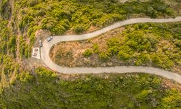 Aerial drone view of a twisty road on the countryside in Corfu Greece. royalty free stock photography