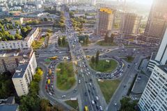 Aerial drone view of two level road junction during rush hour. Traffic jam in busy urban highway with circles. Busy street with lo stock image