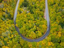 Aerial drone view of U Turn Road Curve in Autumn / Fall foliage overhead. Blue Ridge in the Appalachian Mountains near Asheville,. North Carolina. Curved road royalty free stock photo