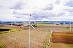 Aerial drone view on wind electricity generator Royalty Free Stock Photos