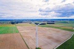 Aerial drone view on wind electricity generator Stock Photo