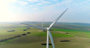Aerial drone view on Wind Power, Turbine, Windmill, Energy Production. Green technology, a clean and renewable energy. A wind turbine is a device that converts stock footage