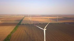 Aerial drone view on wind power, turbine, windmill, energy production - green technology, a clean and renewable energy. Solution stock footage